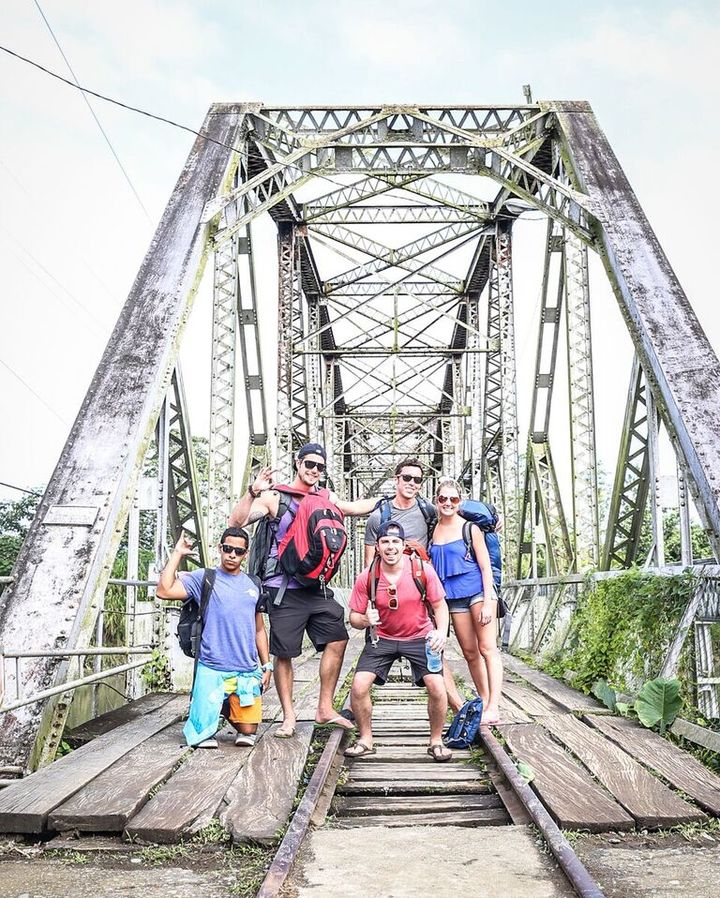 group of people taking a photo on an old bridge panama costa rica border crossing panama travel