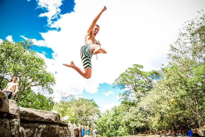 guy flying through the air cliff jumping bocas del toro panama tours