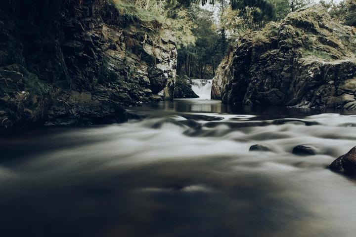 Dipping in Hethpool Linn waterfall